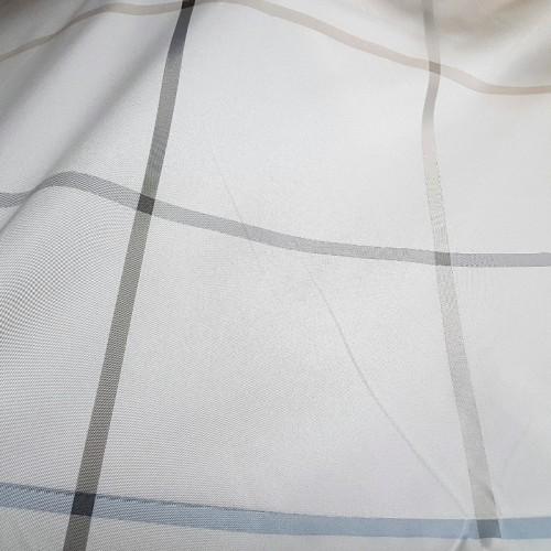 завеса в нежен ванилов цвят с райенца образуващи квадрати в сиво и бежoво Мартекс